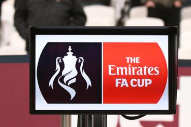 Emirates FA Cup logo in a board
